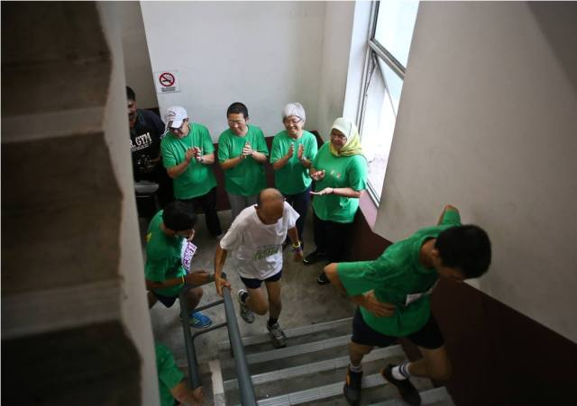 VIPs cheering on as the participants make their way up the 16-storey climb
