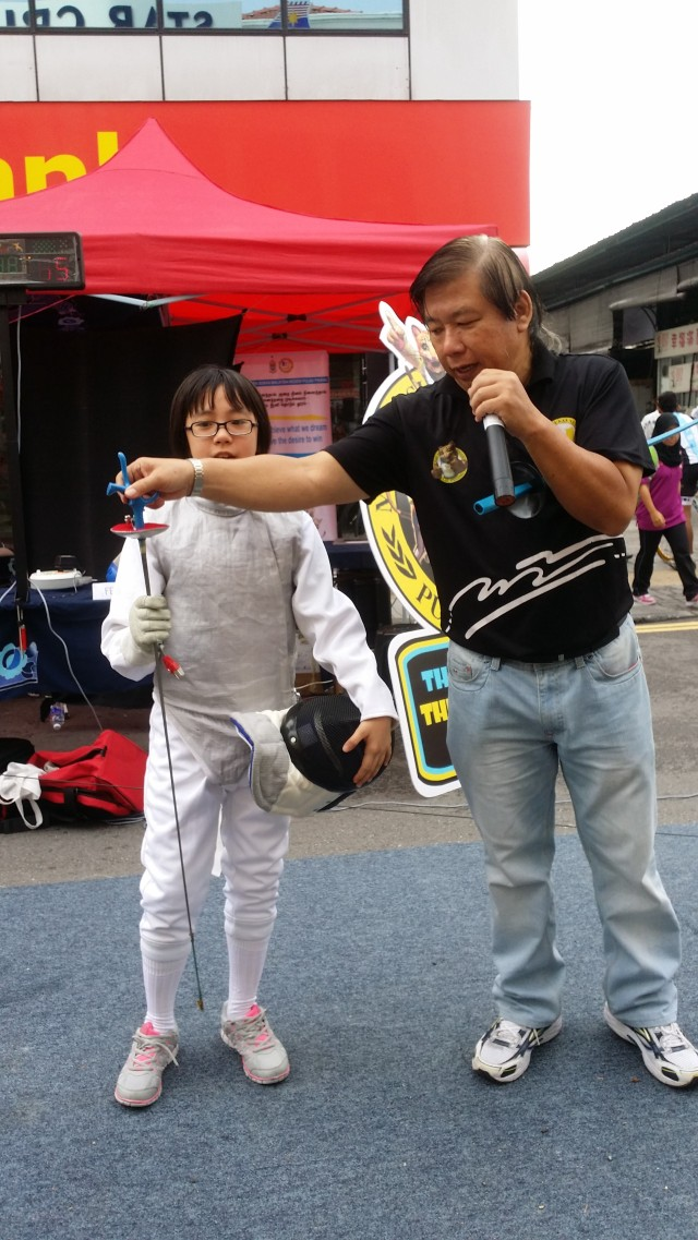Briefing on fencing by coach Lim Peng Jin