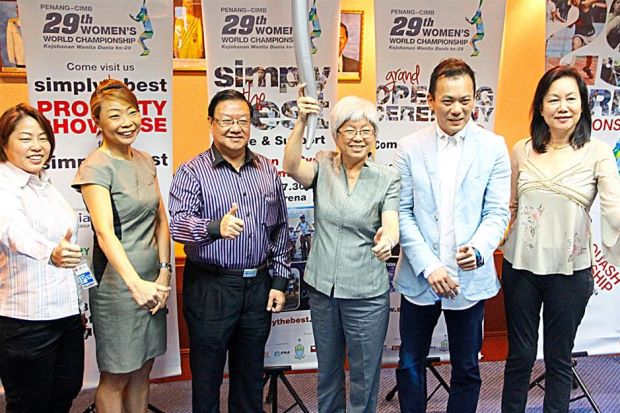 See you there: Chong (third right) holding the torch which will be used in the Torch Run and Bike event. With her are sponsors of the championship.
